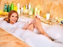 Woman wash leg in bathtube. Young woman wash leg in bathtube royalty free stock images