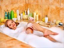 Woman wash leg in bathtube Royalty Free Stock Photography