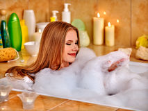 Woman wash leg in bathtube. Young woman wash leg in bathtube stock photo