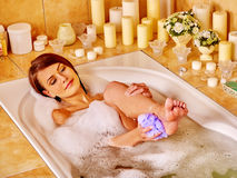 Woman wash leg in bathtube. Young woman wash leg and heel in bathtube stock photo