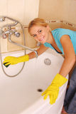 Woman washes a bath Royalty Free Stock Photo