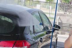 Woman washes a car royalty free stock images