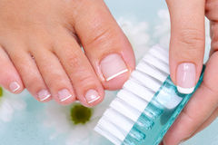 Woman washes and cleans the toenails Royalty Free Stock Photos