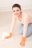 Woman washes floor on her knees Royalty Free Stock Image