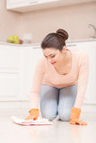 Woman washes floor on her knees Royalty Free Stock Photos