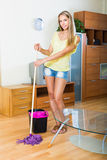 Woman washes the floor with mop Royalty Free Stock Photo