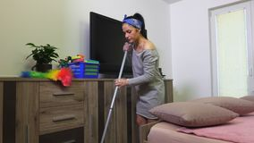Woman washes floor. In room stock video