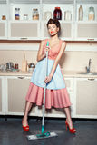 Woman washes the floors. Royalty Free Stock Photos
