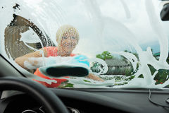Woman washes her car Stock Image