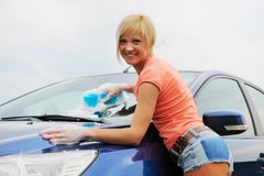 Woman washes her car Royalty Free Stock Photography
