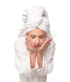 Woman washes her face Royalty Free Stock Photo