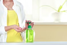 Woman Washes Her Hands,person Using Antibacterial Sanitizer To Desinfect Hands Royalty Free Stock Photography