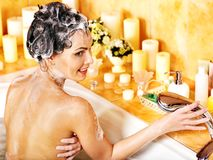 Woman washes her head at bathroom. Royalty Free Stock Photo