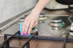 Woman washes a stove Stock Image