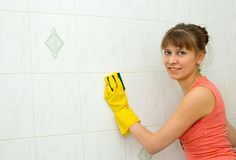 The woman washes a tile. In a bathroom Stock Photos