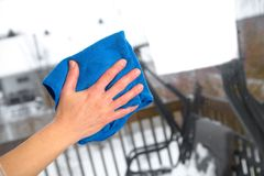 Woman washes a window. Using a rag Royalty Free Stock Images