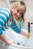 Woman washing bath Stock Photography