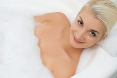 Woman washing in bathroom Stock Photography