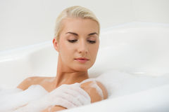 Woman washing in bathroom Stock Photos