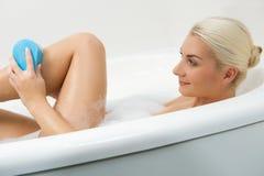 Woman washing in bathroom Royalty Free Stock Photos
