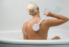 Woman washing in bathroom Stock Photo
