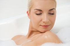 Woman washing in bathroom Royalty Free Stock Photo