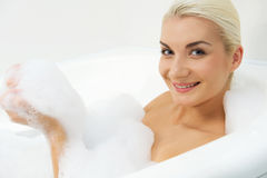 woman washing in bathroom Royalty Free Stock Image