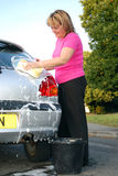 Woman washing car Royalty Free Stock Photos