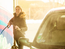 Woman washing car on open air Stock Photography