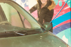 Woman washing car on open air Stock Photo