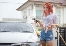 Woman washing a car Stock Photography