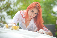 Woman washing a car Royalty Free Stock Photography