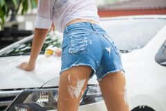 Woman washing a car Royalty Free Stock Images