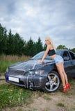 Woman washing car. Royalty Free Stock Photos
