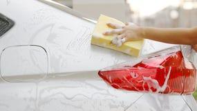 Hand Wringing Out Soapy Car Wash Sponge