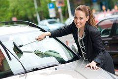 Woman washing car window Stock Images