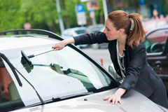 Woman washing car window stock photo