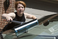 Woman Washing Car Windshield Royalty Free Stock Images