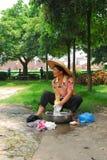 Woman washing cloth. Es at street Royalty Free Stock Photo