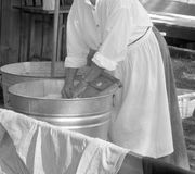 Woman Washing clothes Stock Photography