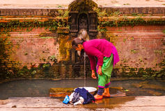 A woman washing clothes in Bhaktapur Stock Photo