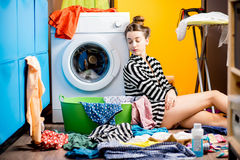 Woman washing clothes at home Stock Photography