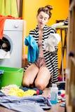 Woman washing clothes at home Royalty Free Stock Photos