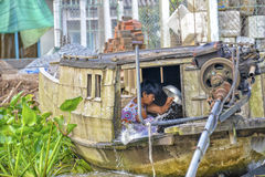 Woman washing clothes in Mekong river Royalty Free Stock Image