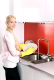 Woman washing dishes Stock Photos