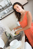 Woman washing dishes in domestic kitchen Stock Photo