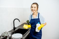Woman washing dishes at home stock images