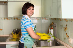 Woman washing dishes in kitchen Stock Photography