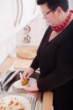 Woman washing dishes Stock Image
