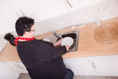 Woman washing dishes Royalty Free Stock Images